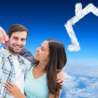 Happy young couple showing new house key — Stok fotoğraf #62478321