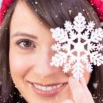 Brunette holding snowflake decoration — Stock Photo #62478593