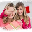 Girl hiding gift from mother — Stock Photo #62478657