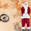 Jolly santa smiling at camera — Stock Photo #62479155