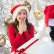 Composite image of little girl getting gift — Stock Photo #62479983