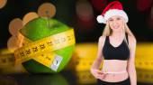 Fit festive young blonde measuring — Stok fotoğraf