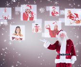 Santa shows something to camera — Stockfoto