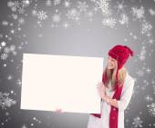 Pretty blonde showing white poster — Stock Photo