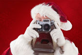 Santa is taking picture — Stockfoto