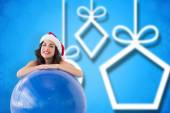 Festive fit brunette leaning on exercise ball — Zdjęcie stockowe