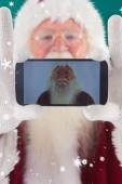 Santa records himself with smartphone — 图库照片