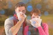 Couple blowing noses into tissues — Stock Photo