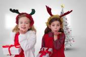 Composite image of cute girls with gifts — Stock Photo