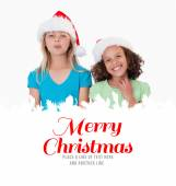 Cheerful girls with Christmas hats — Stock Photo