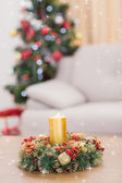 Candle and wreath on table — Stockfoto