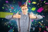 Geeky hipster wearing party hat smiling — Stock Photo