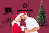 Young festive couple with gift — Stock Photo