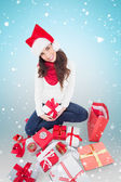 Festive brunette wrapping christmas — Stock Photo