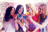 Composite image of friends with drinks — Stock Photo