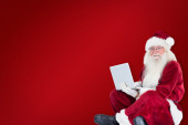 Santa sits and uses a laptop — Foto de Stock
