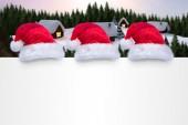 Santa hats on poster — Zdjęcie stockowe
