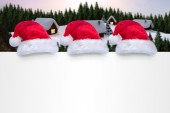 Santa hats on poster — Stok fotoğraf