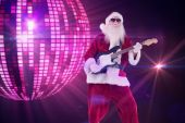 Santa Claus plays guitar — Stock Photo