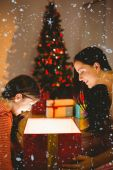 Festive mother and daughter opening a glowing — Stok fotoğraf
