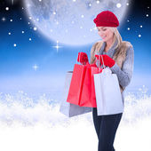 Blonde with shopping bags — Stock Photo