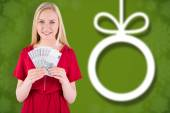 Pretty blonde in red dress showing her cash — Stockfoto