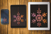 Snowflake against tablet and smartphone — Stock Photo