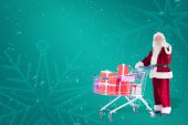 Santa push shopping cart with presents — Stockfoto