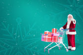 Santa push shopping cart with presents — Foto Stock