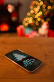 Christmas message against smartphone — Stockfoto