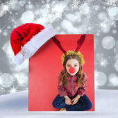 Festive little girl wearing red nose — Stock fotografie