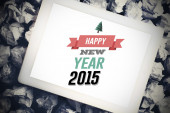 Happy new year against tablet pc — Stockfoto
