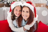 Festive mother and daughter on couch — Stock Photo