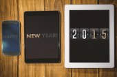 2015 against tablet and smartphone — Stock Photo