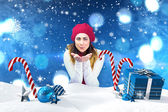 Brunette in winter clothes with hands out — Stock Photo