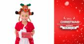 Little girl wearing rudolph headband — Stock Photo