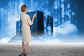 Thinking businesswoman against server towers — Stock Photo