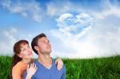 Happy couple looking upwards — Stock Photo