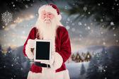 Santa presents tablet PC — Stock Photo