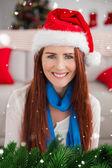 Festive redhead smiling at camera — Stock Photo
