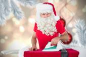 Happy santa claus ironing his jacket — Foto de Stock