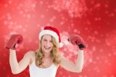 Composite image of festive blonde with boxing gloves — Stockfoto