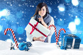 Brunette holding gift and keeping secret — Stock Photo