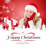 Happy festive blonde — Stock Photo