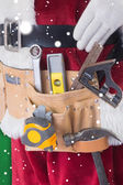 Father Christmas is wearing tool belt — Stockfoto
