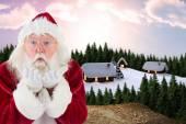 Santa Claus blows something away — Stok fotoğraf