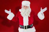 Composite image of portrait of perplexed santa — Stock Photo