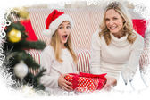 Festive mother and daughter with gift — Stock Photo