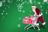 Santa rides on shopping cart — Stock Photo