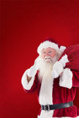 Santa likes to carry his sack — Stock Photo
